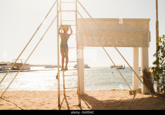Boy playing by seaside, Sharm El Sheikh, Egypt - Stock Image