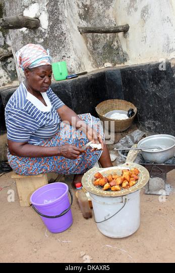 Woman Preparing Fried Chunks Of Farmer's Cheese Called Wagashi or Waagashi - Stock Image