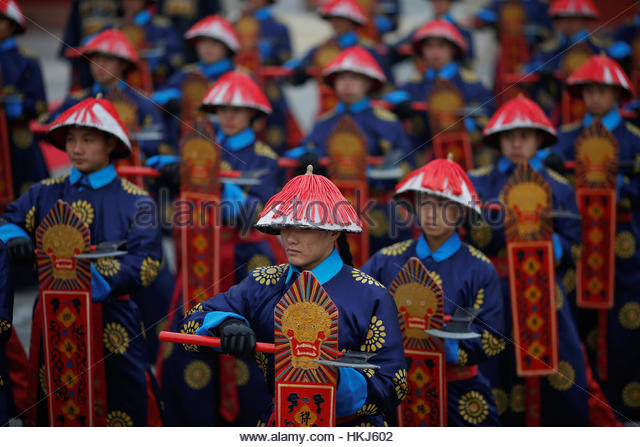 Performers take a part in a re-enactment of an ancient Qing Dynasty ceremony as the Lunar New Year of the Rooster - Stock-Bilder