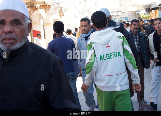 Men in market in El Oued, South East Algeria - Stock Image