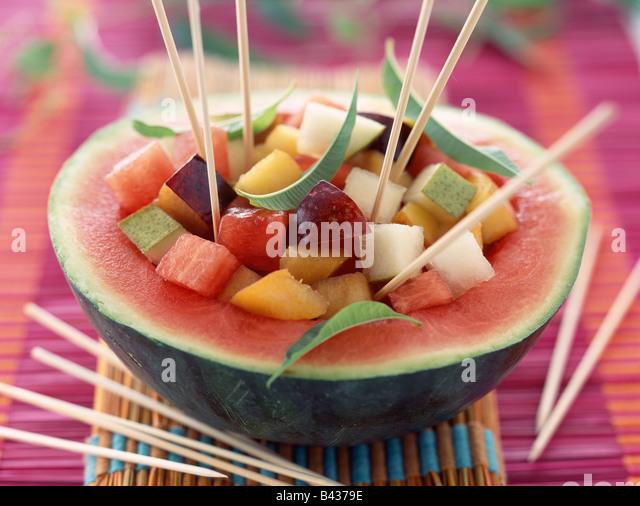fruit salad surprise in melon - Stock Image