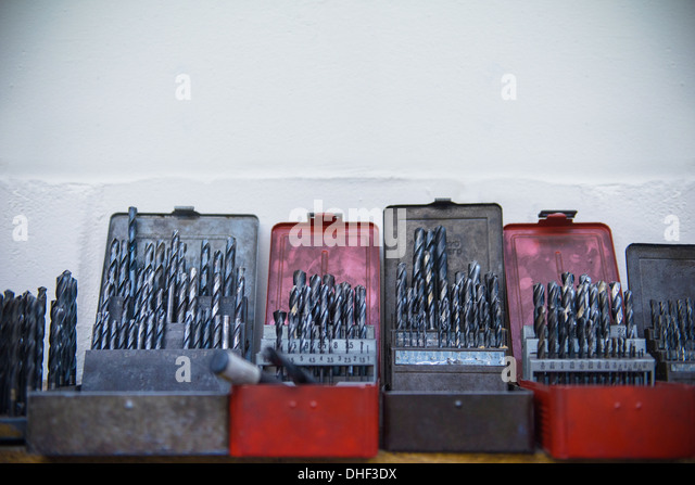 Assorted drill bits in engineering factory - Stock Image