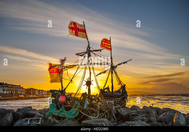 Hoylake, The Wirral, UK. UK Weather. Strong winds on the west coast as the flags of the driftwood Pirate ships signal - Stock Image