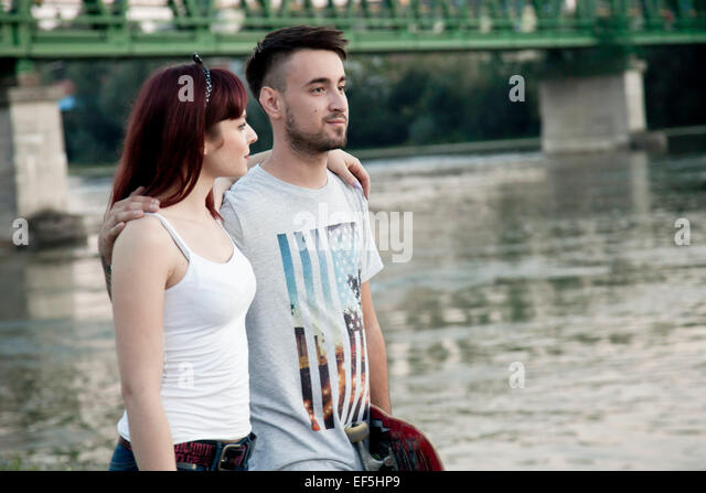 Portrait of happy young couple on the waterfront - Stock-Bilder