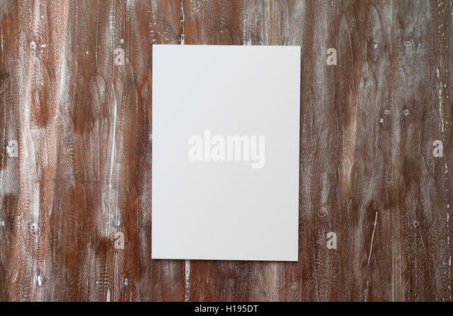 Closeup Blank White Paper Sheet Mockup Natural Wood Table Background. Empty Canvas Painted Brown Desk - Stock Image