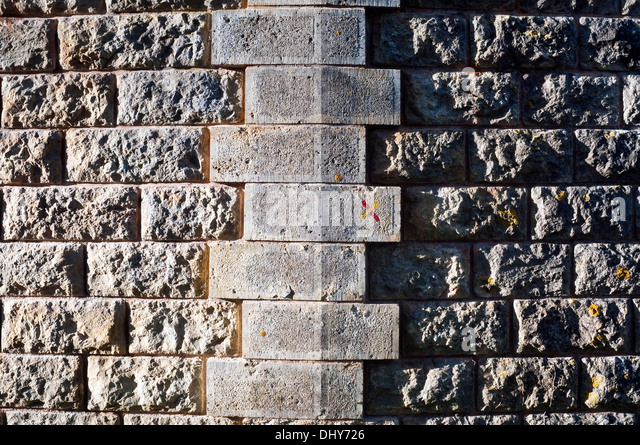 Dressed stone wall courses - France. - Stock Image
