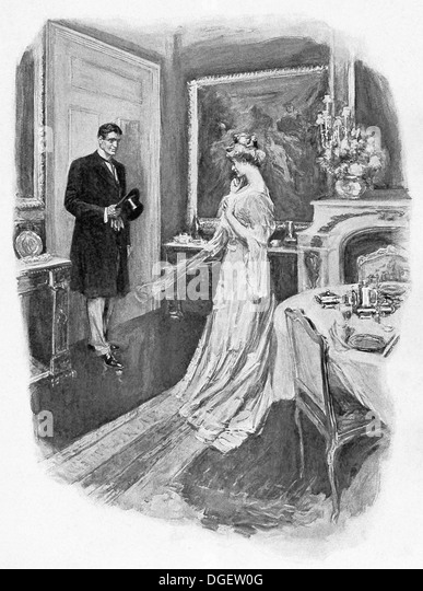 An English man and woman meet in a room adjoining another where there is at a ball in the 1890s, the Victorian period. - Stock Image
