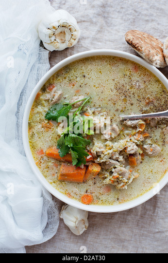 Bowl of stew with herbs and bread - Stock Image