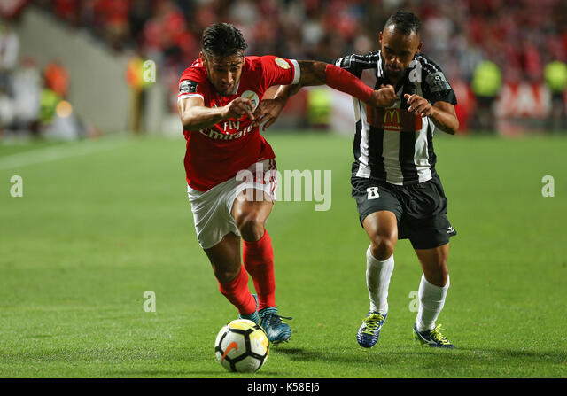 Benfica«s forward Toto Salvio from Argentina (L) and Portimonense«s midfielder Paulinho from Brazil  (R) - Stock Image