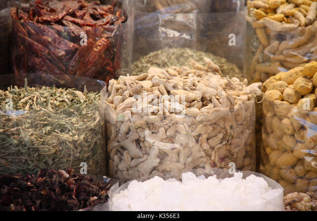 Various Spices for sale in a spice market in an Indian city - Stock Image