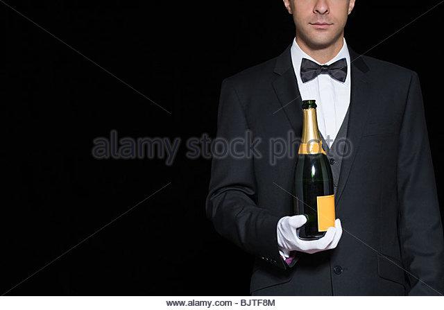 Waiter holding champagne - Stock Image
