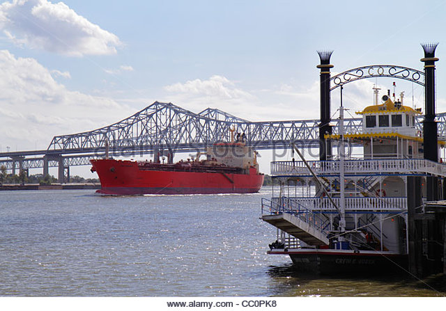 New Orleans Louisiana Spanish Plaza Mississippi River Greater New Orleans Bridge cantilever bridge Creole Queen - Stock Image