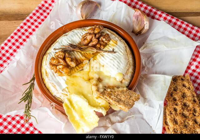 Baked Camembert cheese with Honey, Garlic and Rosemary - Stock Image