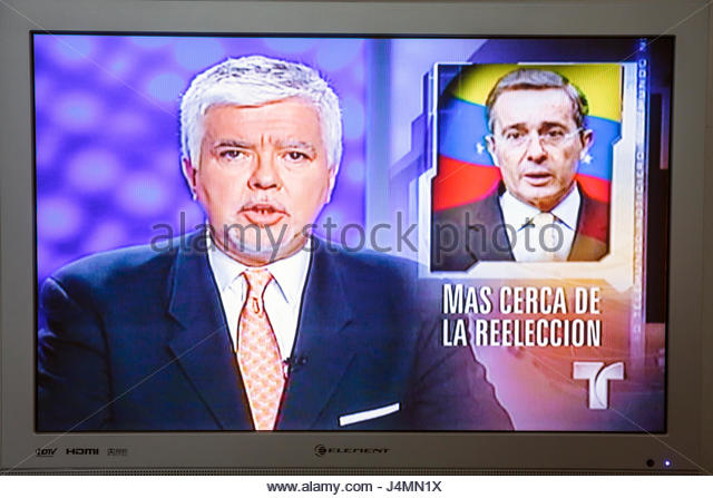 Miami Beach Florida flat panel TV television screen shot media Spanish language Telemundo news newscast broadcast - Stock Image