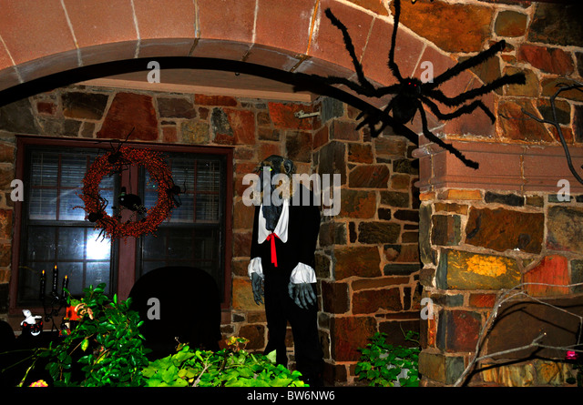 A haunted house decorated for Halloween with a ghoul and spider in Oklahoma, USA. - Stock Image