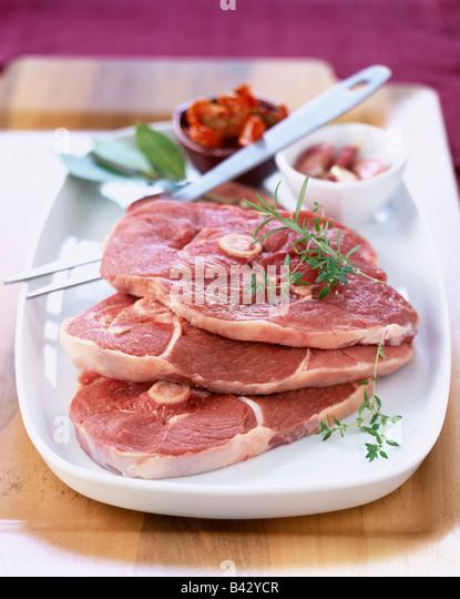 Raw slices of lamb - Stock Image
