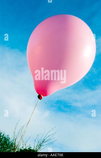 Single pink balloon - Stock Image