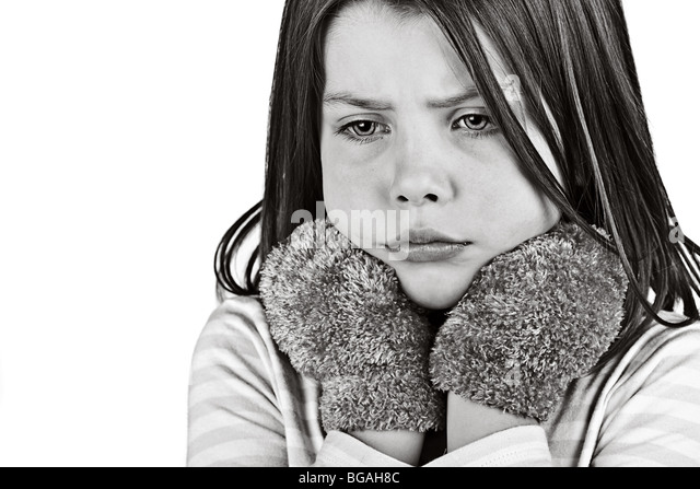 Shot of a Cute Child Looking Cold and Lonely - Stock Image