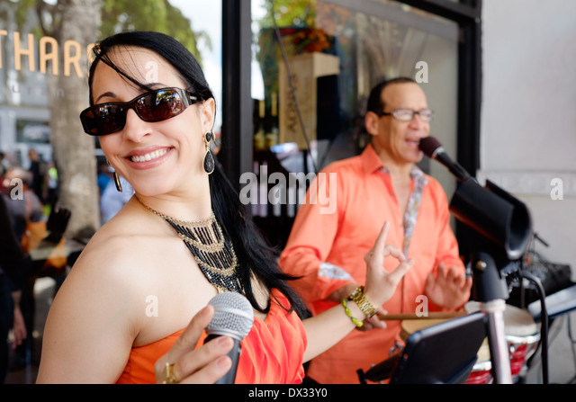 MIAMI - MARCH 9, 2014: Portrait of woman singing and dancing during the 37th Calle Ocho festival, an annual event - Stock Image