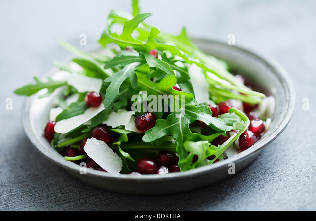 arugula  and pomegranate salad - Stock Image