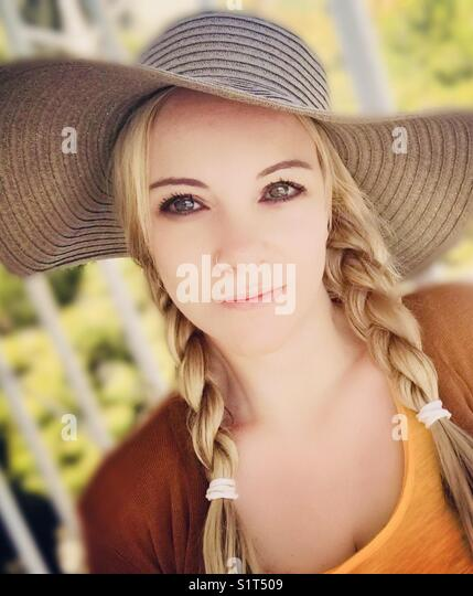 Romantic woman with hat - Stock Image