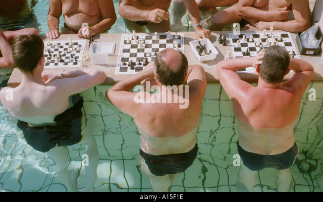 Hungarians and foreign tourists play chess at the Szechenyi baths in Budapest Hungary in late May 2000. The spas - Stock Image