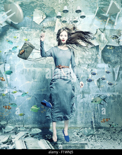 a pretty woman underwater in the flooded interior. creative concept - Stock-Bilder