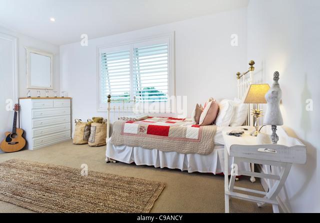 Stylish bright kids bedroom - Stock Image