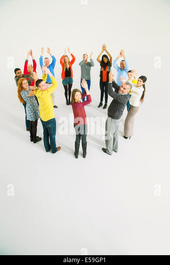 Clapping business people in circle - Stock Image