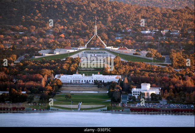Autumn colours surround the Provisional Parliament House and Parliament House Capital Hill Canberra Australia - Stock Image
