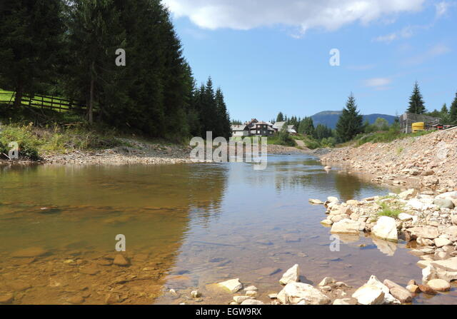 mountain river destroyed by exploitation of stone - Stock-Bilder