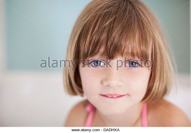 Girl with brown bobbed hair, portrait - Stock Image