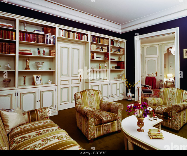 Bookcases living room stock photos bookcases living room for Traditional armchairs for living room