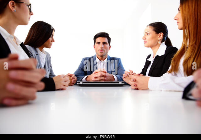 Group of businesspeople sitting on the meeting at office - Stock Image