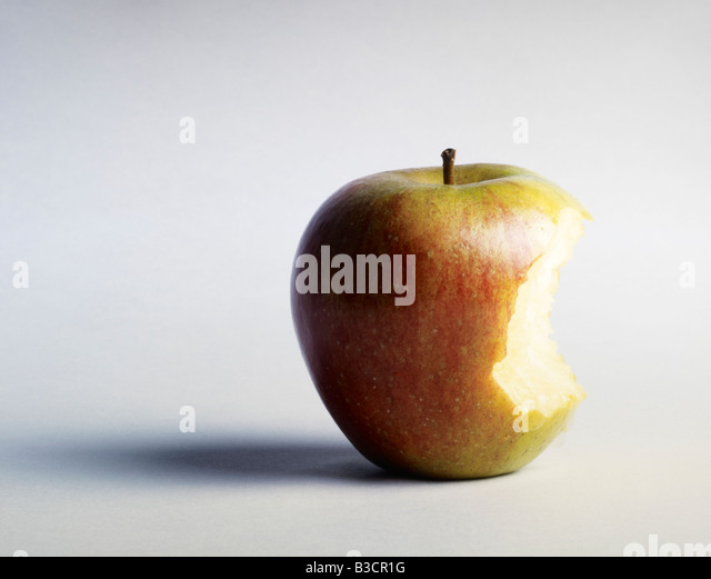 An apple with a bite taken out of it - Stock Image