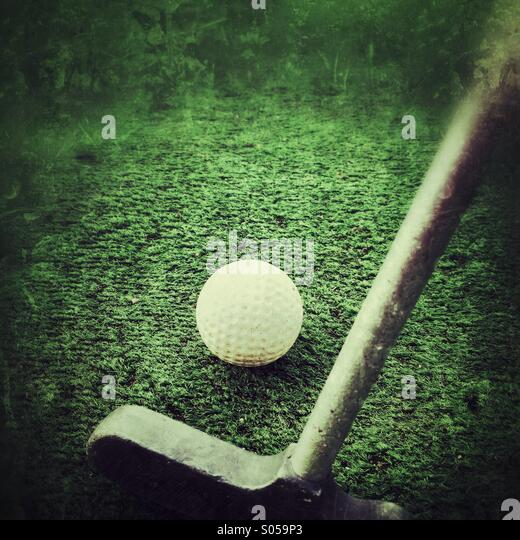 Putter and golf ball on green - Stock Image