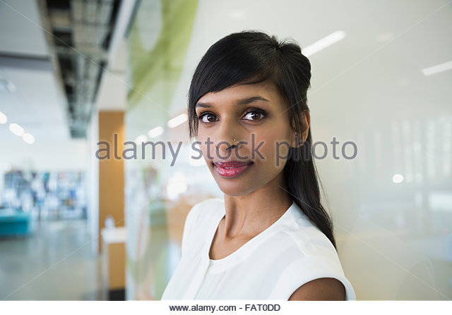 Portrait confident businesswoman - Stock Image