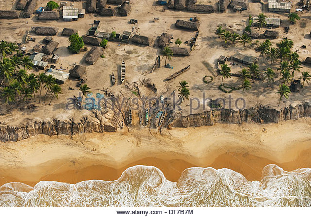 Seagoing fishing canoes hauled out on shore Ghana An elevated view Ghana - Stock Image