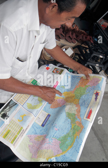 Panama Panama City Ancon Mercado Público Public Market store Hispanic man looking studying map country geography - Stock Image