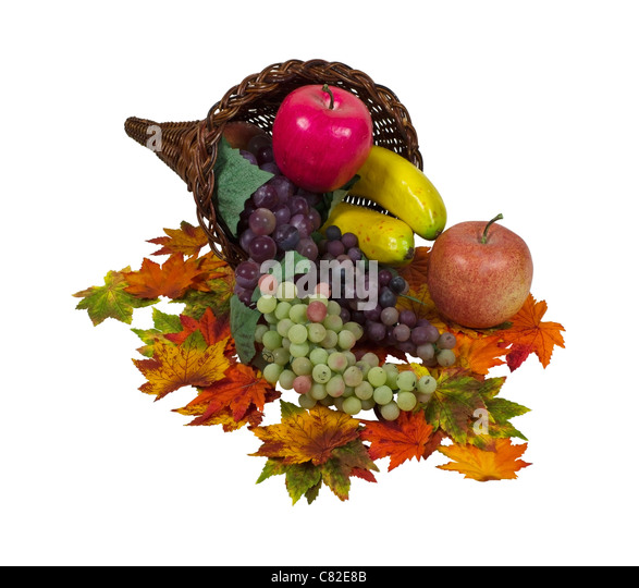 Cornucopia of abundant fruit garnished with leaves - path included - Stock Image