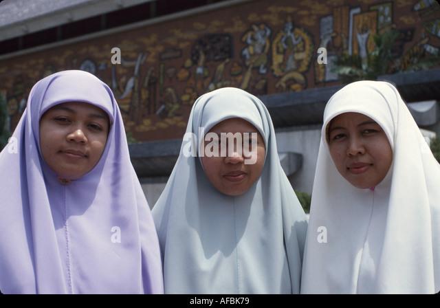 Malaysia Kuala Lumpur National Museum Muslim women head covering - Stock Image