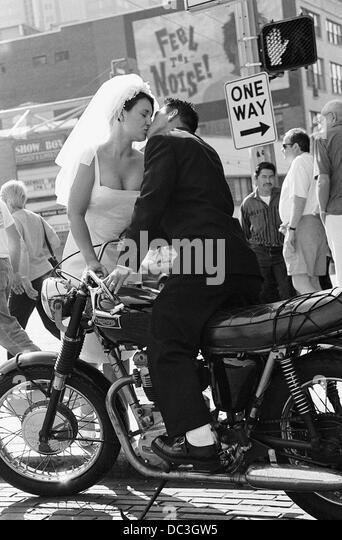 Bride and Groom Kissing on Motorcycle - Stock-Bilder