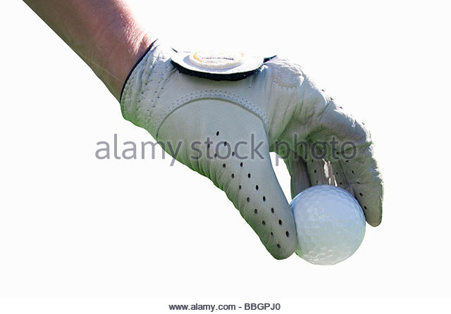 Gloved hand holding golf ball, close up, cut out - Stock Image