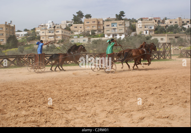 Jerash, Northern Jordan: Charioteers from the Roman Army and Chariot Experience. - Stock Image