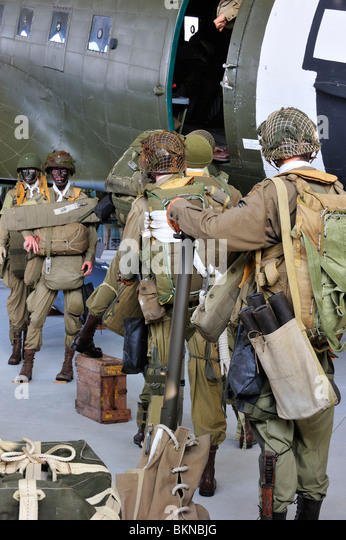 WW2 uniforms of American soldiers and Douglas C-47 airplane in the Airborne Museum at Sainte-Mère-Église, - Stock Image