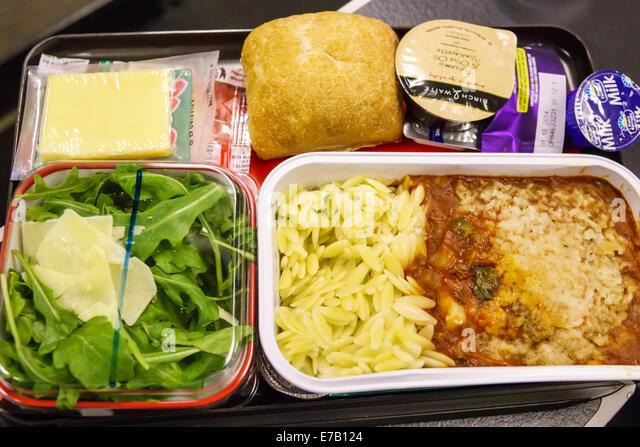 Hawaii Hawaiian Honolulu Qantas Airlines flight from Sydney inflight onboard passenger cabin meal tray salad food - Stock Image