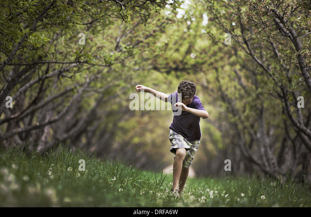 Utah USA child running along natural woodland tunnel - Stock Image