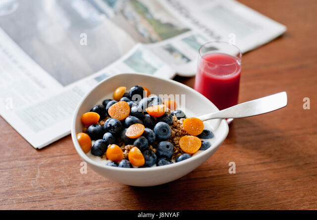 Bowl with fruits on table - Stock-Bilder