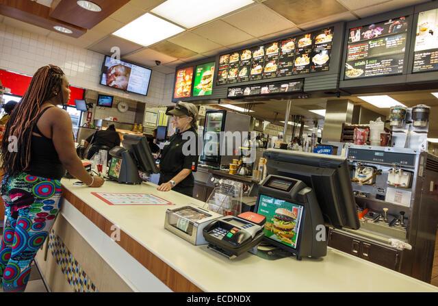 Springfield Illinois McDonald's fast food restaurant counter senior woman employee working Black customer - Stock Image