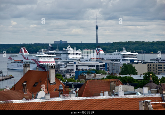 A view over Tallinn showing the port with Cruise Liners and Ferries - Stock Image